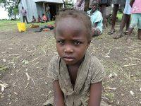 Child-sitting-on-ground-P1000094